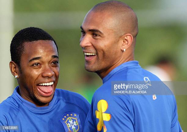 Brazil team's players Robinho and Afonso laugh during a training session in Puerto Ordaz Venezuela 26 June 2007 Brazil takes part in the Copa America...