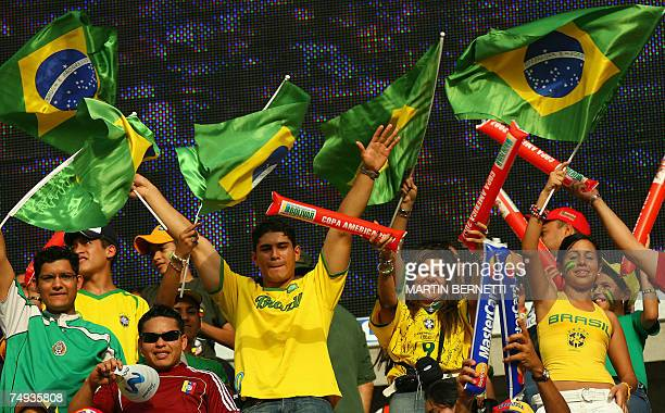 Brazilian supporters cheer for their team as they wait for the start of the match against Brazil in the Copa America football tournament in Puerto...