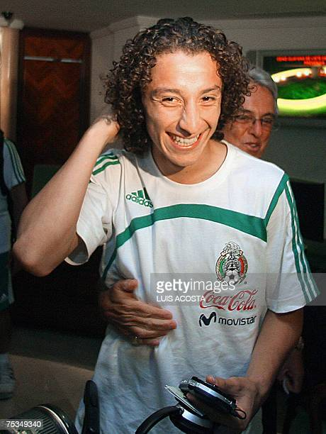 Mexico's Andres Guardado jokes with Justino Compean Mexico's National Footbal Federation president upon arrival at the hotel in Puerdo Ordaz...
