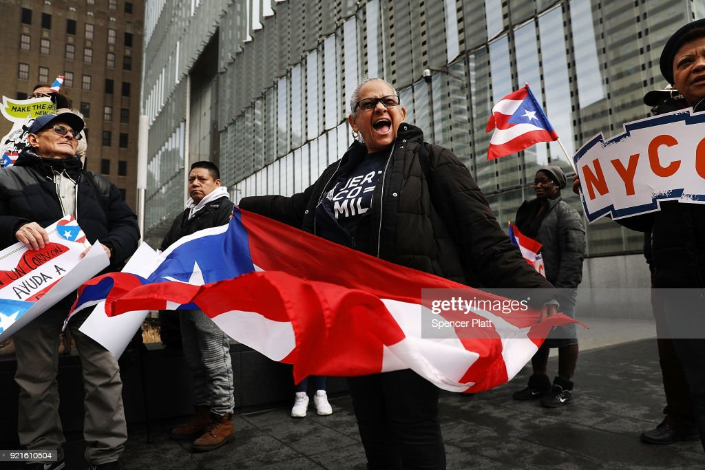 Puerto Rican activists and others participate in a protest outside of New York City's Federal Emergency Management Agency (FEMA) office to call on Congress and FEMA to deliver the aid and resources thousands of Puerto Ricans desperately need to recover on February 20, 2018 in New York City. Nearly six months after Hurricane Maria delivered category 4 destruction to the U.S. territory of Puerto Rico, thousands of island residents are still without running water or electricity.