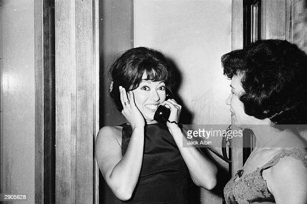 Puerto Rican actor Rita Moreno speaks on the telephone after winning the award for 'Actress In a Supporting Role' for the film 'Westside Story'...