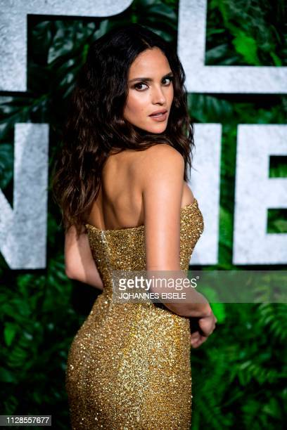 Puerto Rican actress Adria Arjona poses as he arrives for the world premiere of Triple Frontier on March 3 2019 in New York City The movie will be...