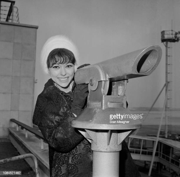 Puerto Rican actress, dancer and singer Rita Moreno at Heathrow Airport, London, UK, 20th February 1963.