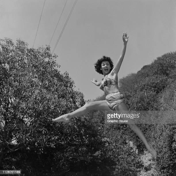 Puerto Rican actress, dancer and singer Rita Moreno jumping in a bikini, US, 5th October 1951.