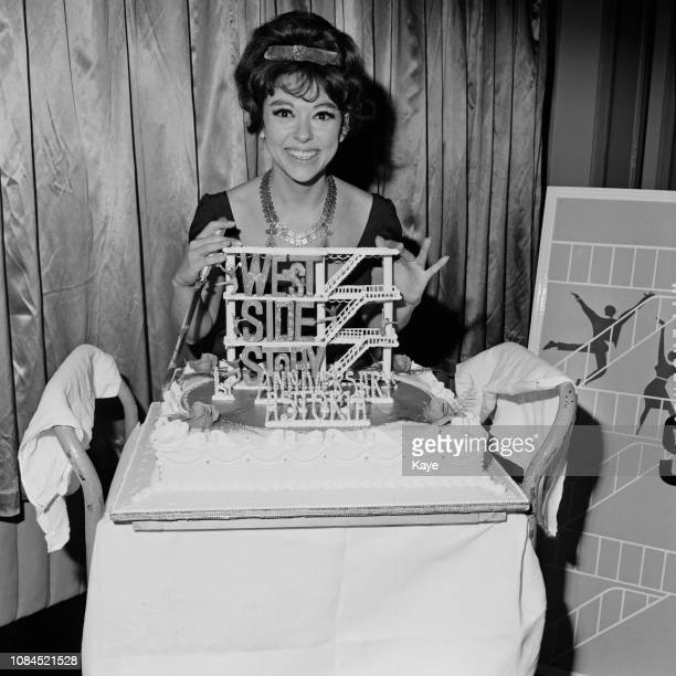 Puerto Rican actress, dancer and singer Rita Moreno with a cake dedicated to 'West Side Story', UK, 25th February 1963.