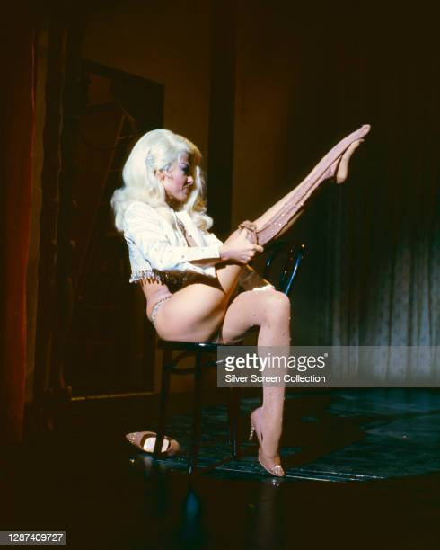 Puerto Rican actress, singer and dancer Rita Moreno as Dolores Gonzales, performing a striptease in the neo-noir film 'Marlowe', 1969.