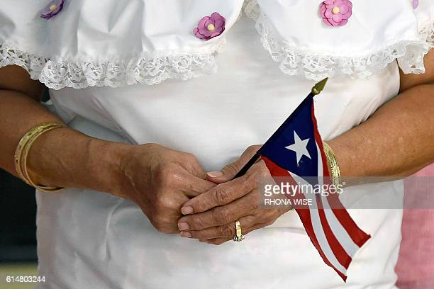 Puerto Rican American Marilie Vergaro holds the Puerto Rican flag as she celebrates Hispanic Heritage during a breakfast at the Kingdom of God Church...