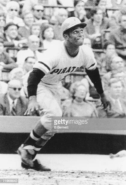 Puerto Rican baseball player Roberto Clemente of the Pittsburgh Pirates smiles as he hits a home run during game six of the World Series against the...