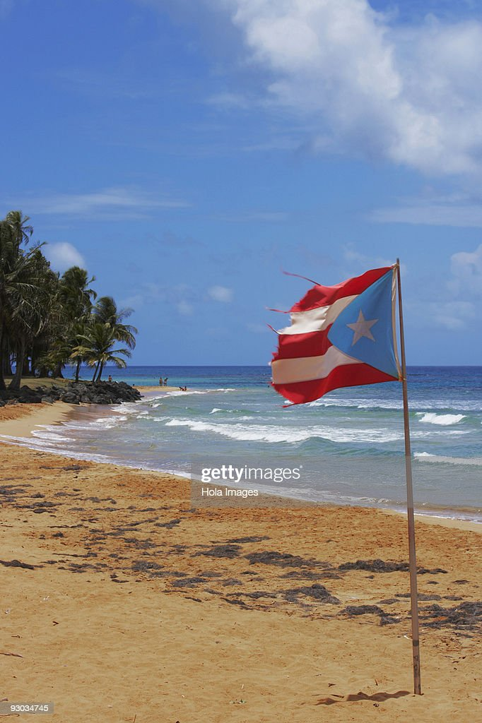 Puerto Rican Flag Fluttering On The Beach Luquillo Rico Stock Photo