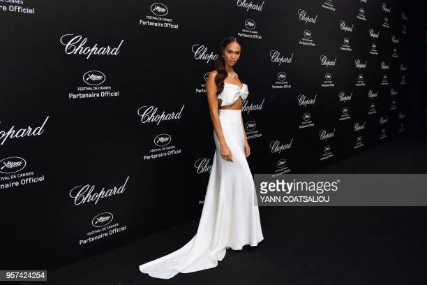Puerto Rican model Joan Smalls poses as she arrives on May 11 2018 for the Chopard party on the sidelines of the 71st edition of the Cannes Film...