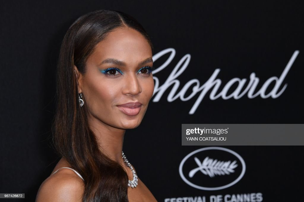 Puerto Rican model Joan Smalls poses as she arrives on May 11, 2018 for the Chopard party on the sidelines of the 71st edition of the Cannes Film Festival in Cannes, southern France.