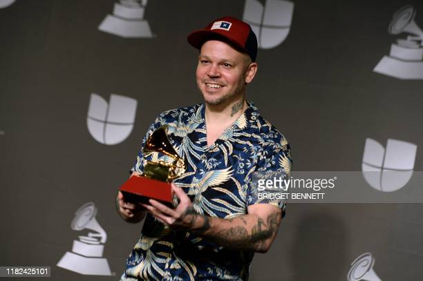 Puerto Rican musician Residente poses in the press room with the award for Best Short Form Music Video during the 20th Annual Latin Grammy Awards in...