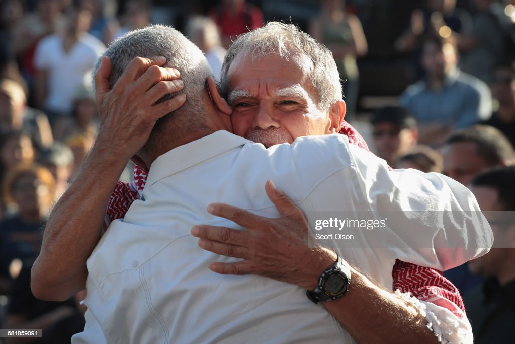 Puerto Rican nationalist Oscar López Rivera (R) is greeted by supporters on May 18, 2017 in Chicago, Illinois. López, who once lived in Chicago was released from federal custody yesterday, his prison sentence being commuted by President Barack Obama before he left office. Lopez was one of the leaders of the Armed Forces of National Liberation (FALN), a Puerto Rican group that claimed responsibility for more than 100 bombings at government buildings, department stores, banks and restaurants in New York, Chicago, Washington D.C. and Puerto Rico during the 1970s and early 1980s.