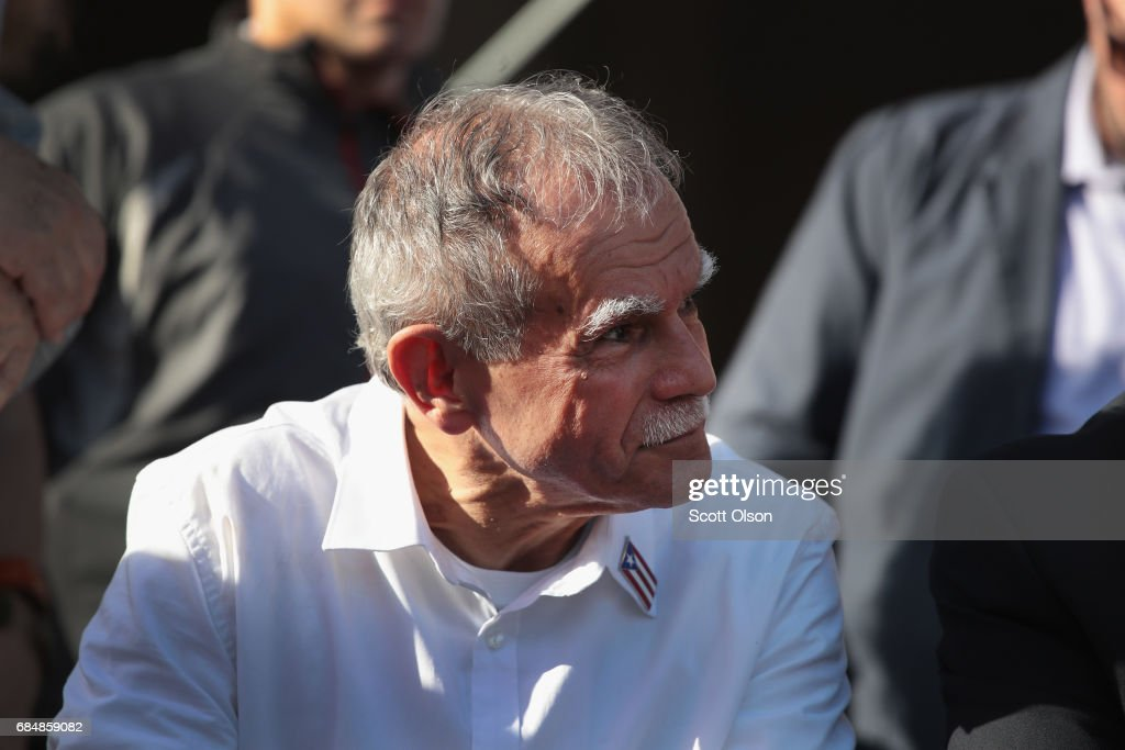 Puerto Rican nationalist Oscar López Rivera listens to speakers during a rally held in his honor on May 18, 2017 in Chicago, Illinois. López, who once lived in Chicago was released from federal custody yesterday, his prison sentence being commuted by President Barack Obama before he left office. Lopez was one of the leaders of the Armed Forces of National Liberation (FALN), a Puerto Rican group that claimed responsibility for more than 100 bombings at government buildings, department stores, banks and restaurants in New York, Chicago, Washington D.C. and Puerto Rico during the 1970s and early 1980s.