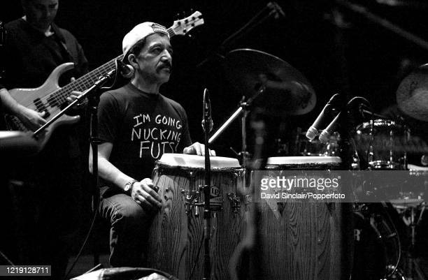Puerto Rican percussionist Milton Cardona performs live on stage at the Barbican in London on 5th March 2002