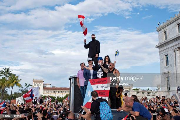Puerto Rican rapper Rene Perez aka Residente speaks alongside Puerto Rican reggaeton singer Bad Bunny and Puerto Rican actor Benicio del Toro as they...