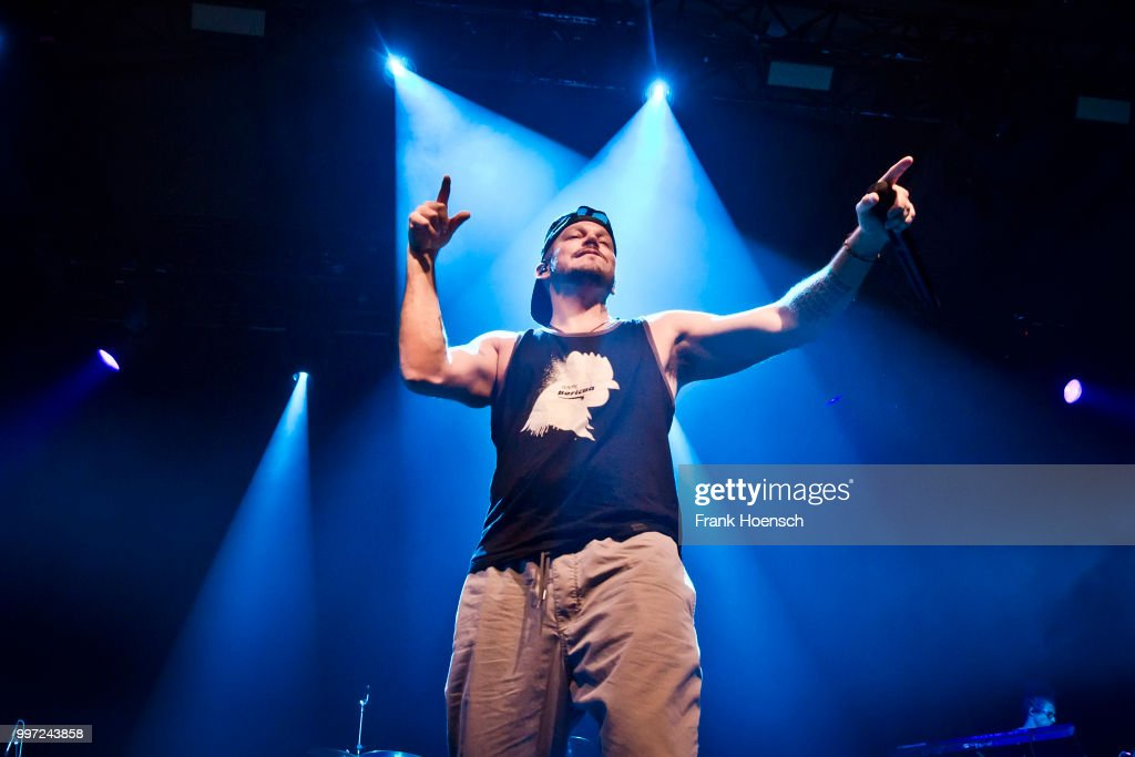 Puerto Rican rapper Rene Perez Joglar aka Residente performs live on stage during a concert at the Columbiahalle on July 12, 2018 in Berlin, Germany.