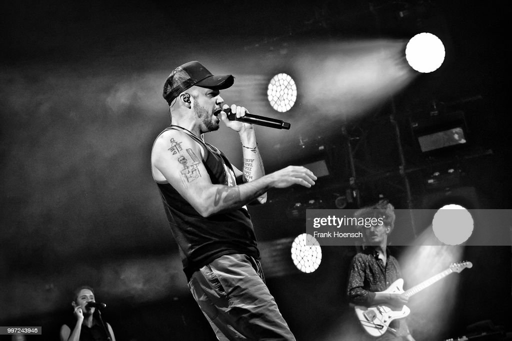 Image has been converted to black and white.) Puerto Rican rapper Rene Perez Joglar aka Residente performs live on stage during a concert at the Columbiahalle on July 12, 2018 in Berlin, Germany.