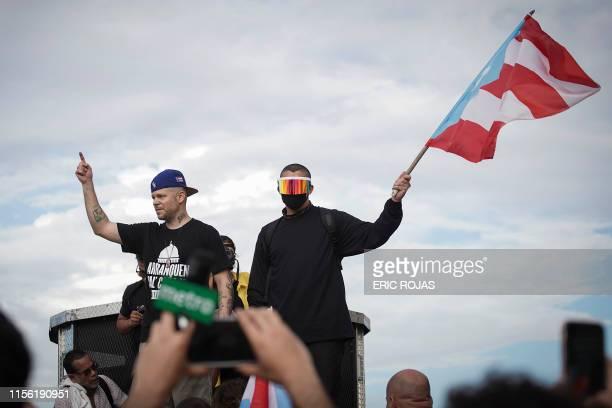 Puerto Rican reggaeton singer Bad Bunny and Puerto Rican rapper Rene Perez aka Residente take part of a demonstration demanding Governor Ricardo...