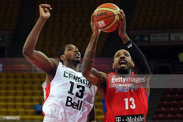 Puerto Rican Renaldo Balkman tries to score despite the close mark of Canada's Tristan Thompson during their 2014 Basketball World Cup qualifier held...