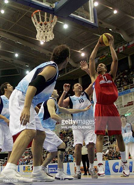 Puerto Rican Ricardo Sanchez throws to the basket marked by Argentina's Roman Gonzalez during their semifinal match at the XV Pan American Games...