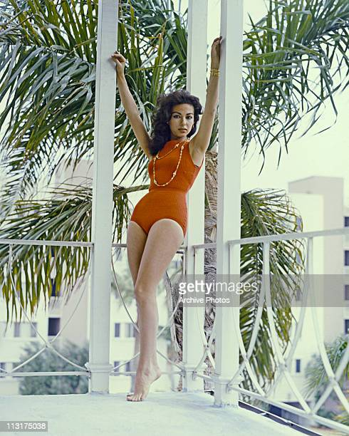 Puerto Rican singer and actress Rita Moreno poses on a balcony circa 1961