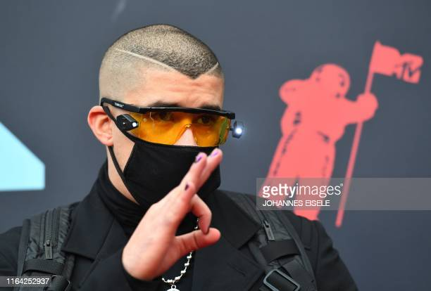 TOPSHOT Puerto Rican singer Bad Bunny arrives for the 2019 MTV Video Music Awards at the Prudential Center in Newark New Jersey on August 26 2019