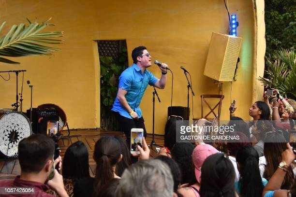 Puerto Rican singer Frankie Negron performs during Latinas en Marcha en election rally with other Latin American celebrities in Miami Florida on...