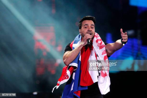 Puerto Rican singer Luis Fonsi performs at the 59th Vina del Mar International Song Festival on February 21 2018 in Vina del Mar Chile / AFP PHOTO /...