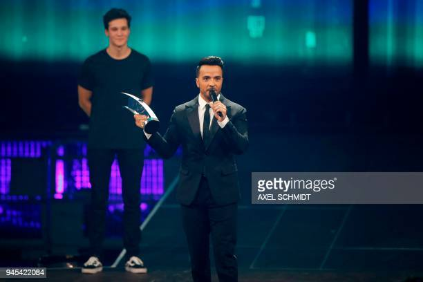 Puerto Rican singer Luis Fonsi receives the International newcomer award during the 2018 Echo Music Awards ceremony on April 12 2018 in Berlin / AFP...