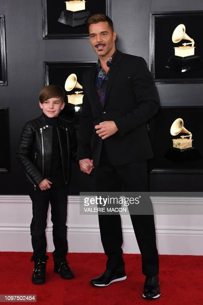 Puerto Rican singer Ricky Martin and son arrive for the 61st Annual Grammy Awards on February 10 in Los Angeles