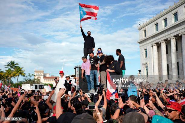 Puerto Rican singer Ricky Martin Puerto Rican rapper Rene Perez aka Residente Puerto Rican reggaeton singer Bad Bunny take part of a demonstration...