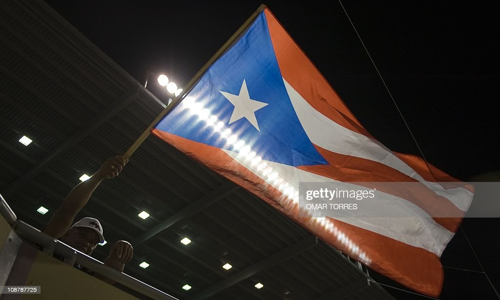 A Puerto Rican supporters wave his national flag during the Caribbean Series baseball game between Venezuela and Puerto Rico at the Isidoro Garcia stadium on February 02, 2011, in Mayaguez, Puerto Rico. AFP PHOTO