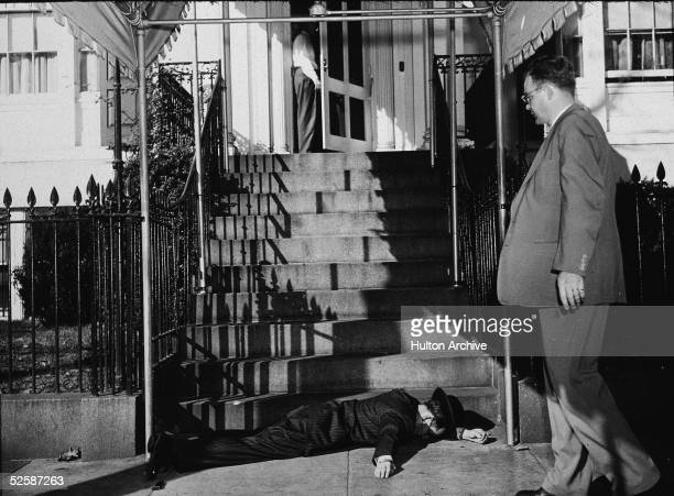 Puerto Rican wouldbe assassin Oscar Collazo lies at the foot of the steps leading up the Blair House Washington DC November 1 1950 American President...