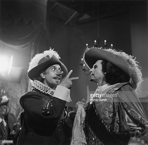 Puerto Ricanborn actor Jose Ferrer gestures as he talks to Belgian actor Albert Cavens during shooting on the set of director Michael Gordon's film...