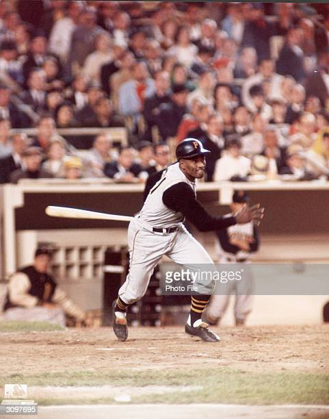 Puerto Ricanborn baseball player Roberto Clemente starts to run towards first base after getting a hit for the Pittsburgh Pirates 1960s