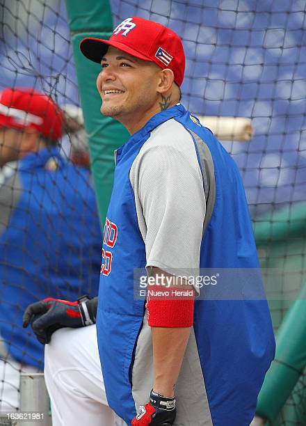 Puerto Rico catcher Yadier Molina is seen during batting practice before the World Baseball Classic elimination game between Italy and Puerto Rico at...