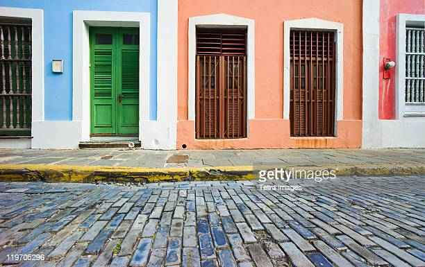 puerto rico, old san juan, door in houses on brick street - puerto rico stock pictures, royalty-free photos & images