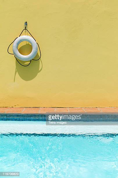 Puerto Rico, Old San Juan, Lifebelt hanging on yellow wall by swimming pool