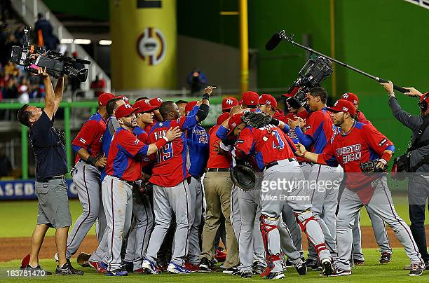Puerto Rico reacts to winning a World Baseball Classic second round game against the United States at Marlins Park on March 15 2013 in Miami Florida