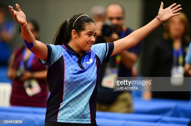 Puerto Rico's Adriana Diaz celebrates during the women's table tennis match against Mexico's Yadira Silva during the 2018 Central American and...
