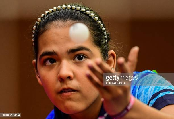 Puerto Rico's Adriana Diaz eyes the ball during a women's table tennis match against Mexico's Yadira Silva during the 2018 Central American and...