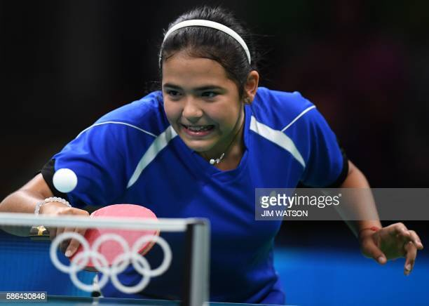 Puerto Rico's Adriana Diaz hits a shot in her women's singles qualification round table tennis match at the Riocentro venue during the Rio 2016...