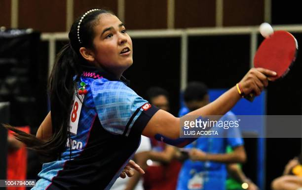 Puerto Rico's Adriana Diaz plays a women's table tennis match against Mexico's Yadira Silva during the 2018 Central American and Caribbean Games in...