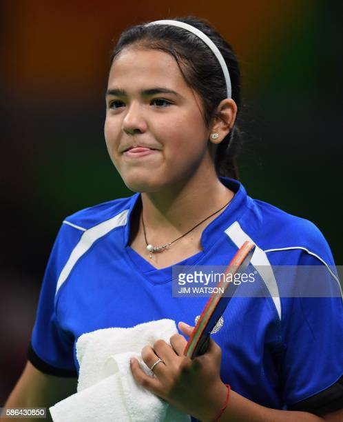 Puerto Rico's Adriana Diaz reacts after beating Nigeria's Olofunke Oshonaike in their women's singles qualification round table tennis match at the...