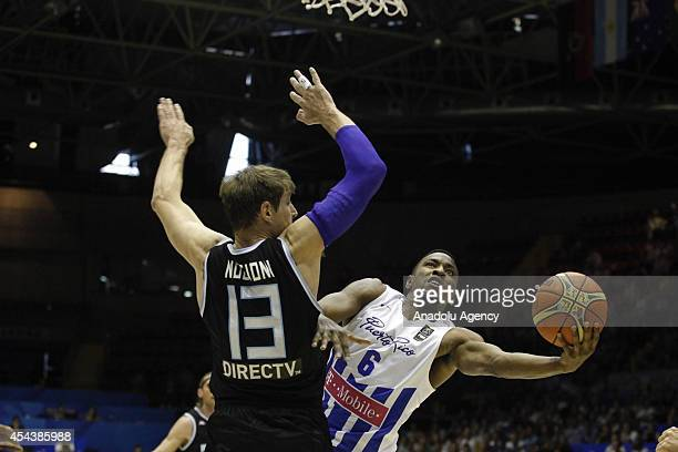 Puerto Rico's Alex Franklin vies with Argentina's Andres Nocioni during the 2014 FIBA World basketball championships group B match between Puerto...