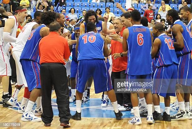 Puerto Rico's and Dominican Republic basketball players celebrate togheter at the end of their semifinal match at the XVI PanAmerican Games in...