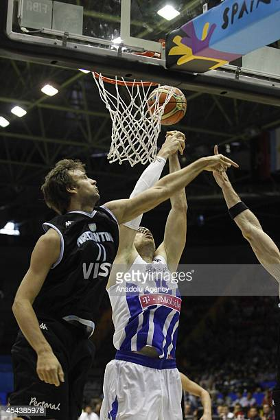 Puerto Rico's Daniel Santiago vies with Argentina's Marcos Delia during the 2014 FIBA World basketball championships group B match between Puerto...