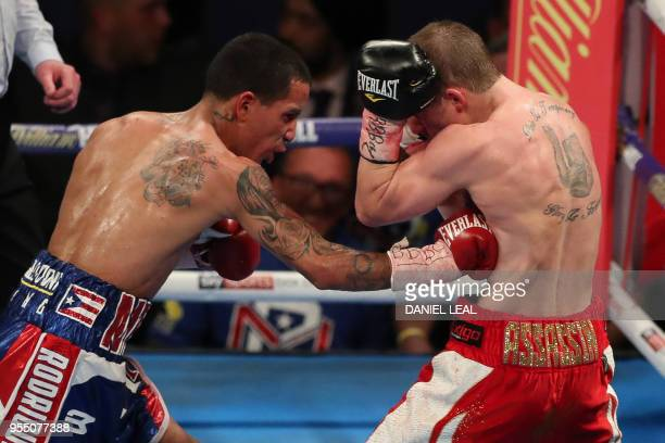 Puerto Rico's Emmanuel Rodriquez fights Britain's Paul Butler in their IBF bantamweight contest at The O2 Arena in London, England, on May 5, 2018. -...