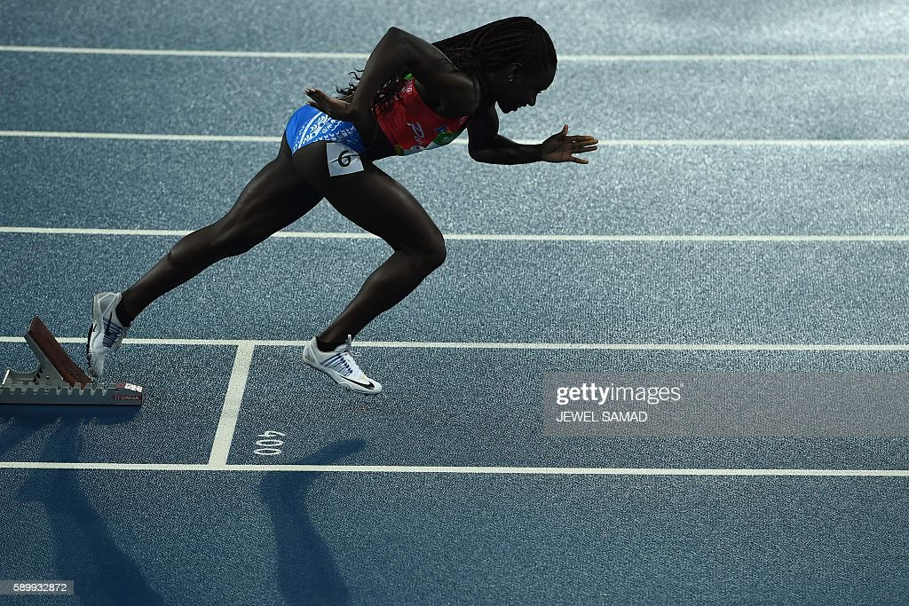 TOPSHOT - Puerto Rico's Grace Claxton competes in the Women's 400m Hurdles Round 1 during the athletics event at the Rio 2016 Olympic Games at the Olympic Stadium in Rio de Janeiro on August 15, 2016. / AFP / Jewel SAMAD
